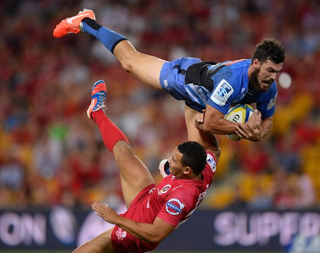 BRISBANE, AUSTRALIA - APRIL 05: Jayden Hayward of the Force collides midair with Jonah Placid of the Reds during the round eight Super Rugby match between the Reds and the Force at Suncorp Stadium on April 5, 2014 in Brisbane, Australia. (Photo by Ian Hitchcock/Getty Images)