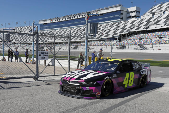 Jimmie Johnson (48) returns to the garages after a NASCAR auto race practice at Daytona International Speedway, Saturday, Feb. 8, 2020, in Daytona Beach, Fla. (AP Photo/Terry Renna)