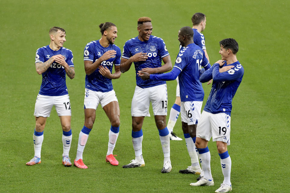 Everton players celebrating a goal against Brighton during their English Premier League clash.