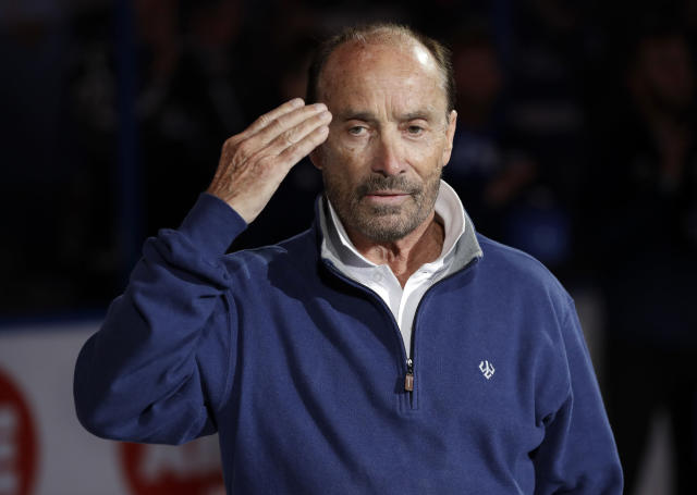 Country entertainer Lee Greenwood salutes after singing the National Anthem before an NHL hockey game between the Tampa Bay Lightning and the Ottawa Senators Tuesday, March 13, 2018, in Tampa, Fla. (AP Photo/Chris O'Meara)