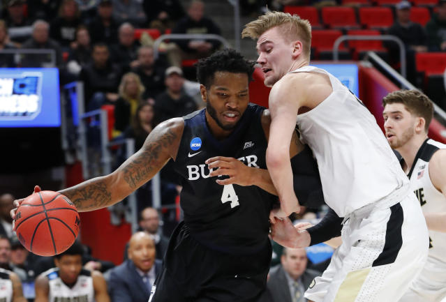Butler forward Tyler Wideman (4) drives on Purdue forward Matt Haarms (32) during the first half of an NCAA men's college basketball tournament second-round game in Detroit, Sunday, March 18, 2018. (AP Photo/Paul Sancya)