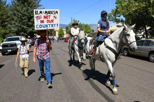 Protesters met with jeers by crowd with guns in Nevada city