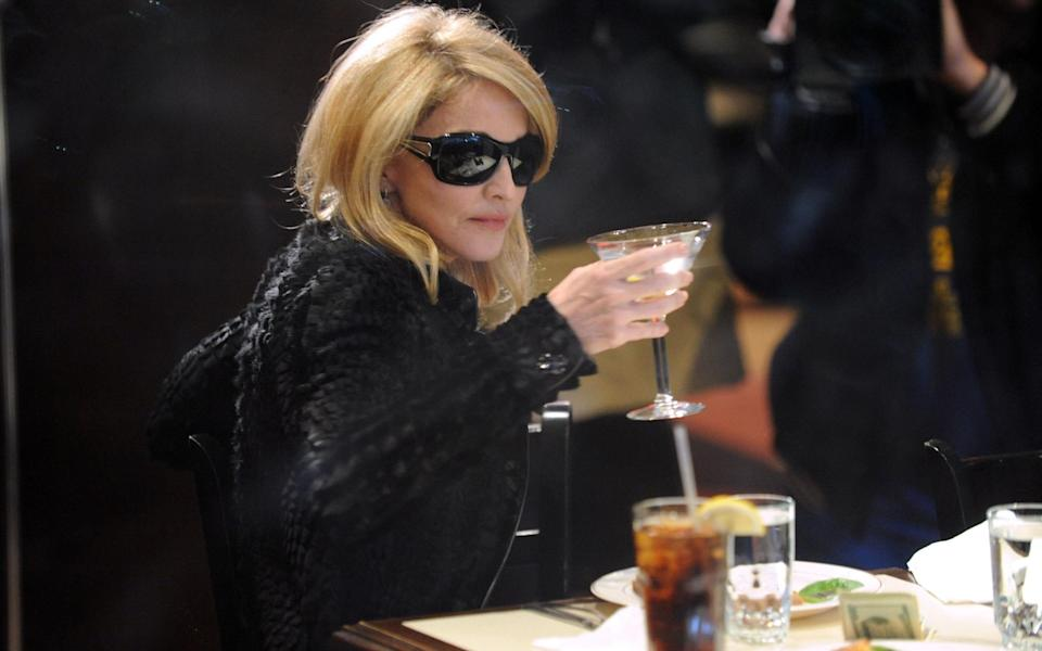madonna drinking gin mert alas seventy one - Getty Images