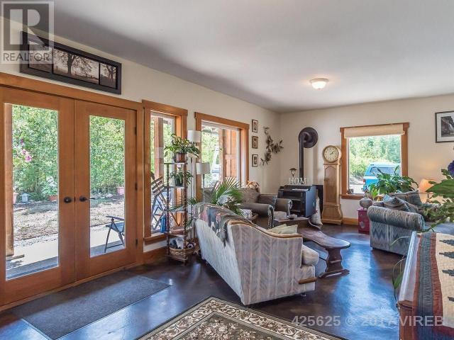 "<p><a href=""https://www.zoocasa.com/qualicum-beach-bc-real-estate/4611411-1310-meadowood-way-qualicum-beach-bc-v9k2s4-425625"" rel=""nofollow noopener"" target=""_blank"" data-ylk=""slk:1310 Meadowood Way, Qualicum Beach, B.C."" class=""link rapid-noclick-resp"">1310 Meadowood Way, Qualicum Beach, B.C.</a><br> The cottage-style home has lots of homey features, such as a private rear patio.<br> (Photo: Zoocasa) </p>"