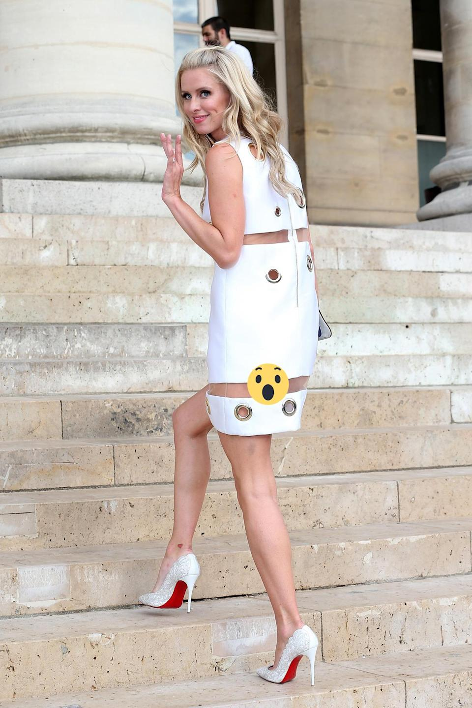 <p>Nicky's Versace mini dress may've showed off the socialite's enviable frame, but it also game onlookers a cheeky view of her behind as she climbed the steps to the luxe label's haute couture fashion show. <i>[Photo: Getty]</i></p>