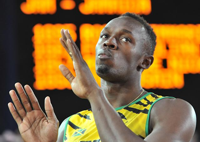 Jamaica's Usain Bolt waits for the start of the heats of the men's 4 x 100m relay athletics event at Hampden Park during the 2014 Commonwealth Games in Glasgow, Scotland on August 1, 2014 (AFP Photo/Glyn Kirk )