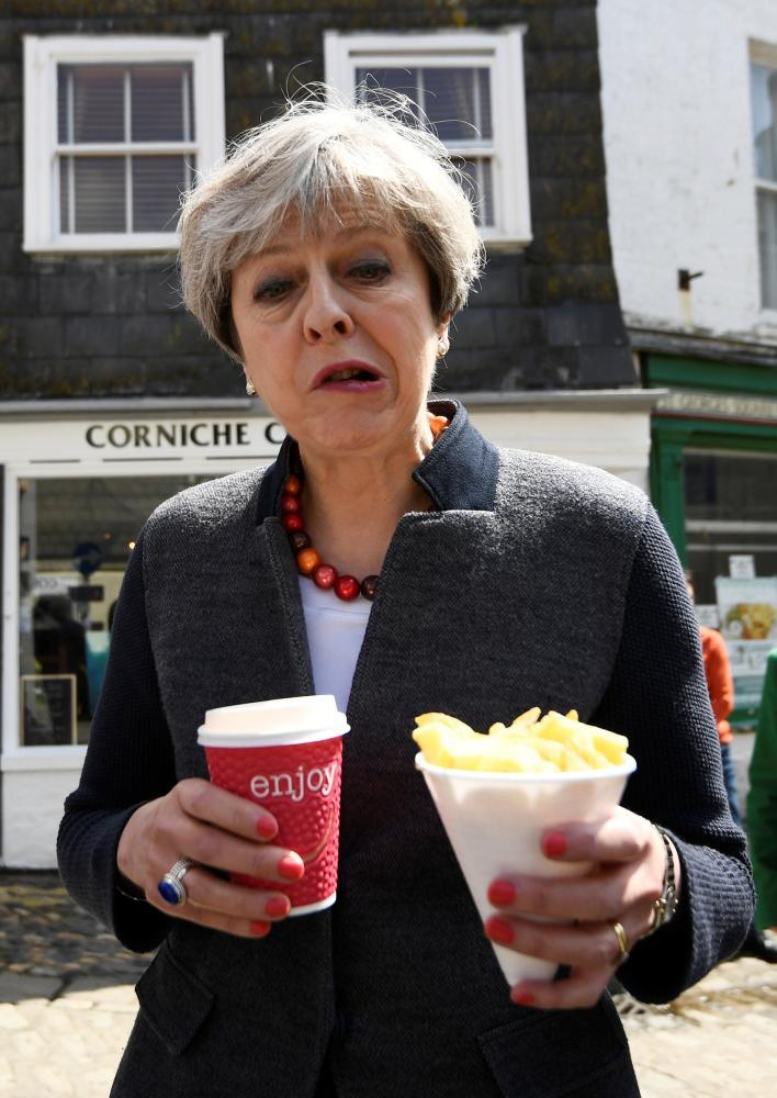 Theresa May does not look like she is enjoying the seaside experience