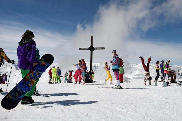 People take part in Ugly Skiing Day in Axams, near the summit cross, Austria, April 6, 2019. REUTERS/Angelika Warmuth
