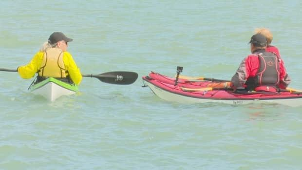 Karen Mitchell and John Lesperance, members of the Windsor-Essex Canoe Club stress the importance of safety for new members and new paddlers.  (CBC - image credit)