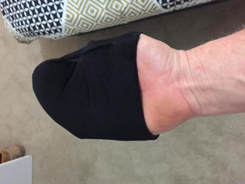 A tradesman's post went viral after he posted this picture showing the struggles of fake tanning his girlfriend with a tanning mit that's too small. Photo: Facebook