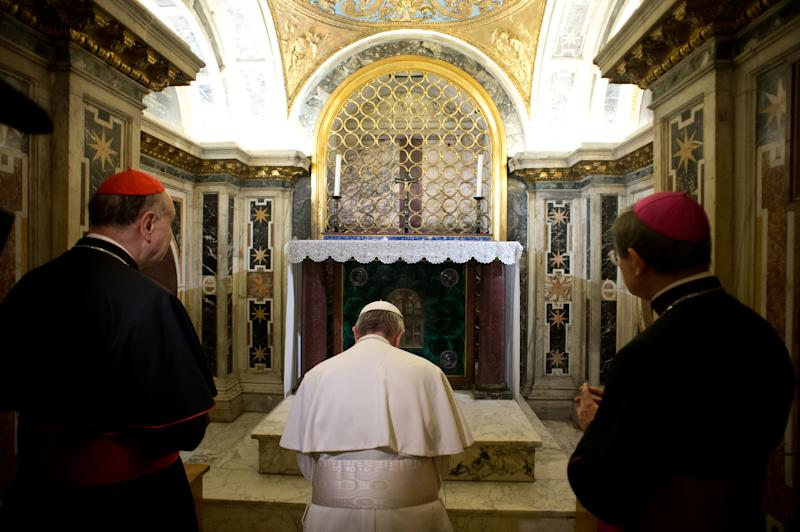 "FILE - In this April 1, 2013 file photo made available by the Vatican newspaper L'Osservatore Romano, Pope Francis kneels in prayer in front of what is believed to be the burial site of St. Peter's in the necropolis under St. Peter's Basilica at the Vatican. The Vatican's decision to publicly exhibit the purported relics of the Apostle Peter for the first time this weekend has spotlighted the intense scientific debate over whether the bones actually belong to the first bishop of Rome. No Pope has ever definitively declared the bones to be Peter's, though Pope Paul VI in 1968 said fragments found in the necropolis under St. Peter's Basilica were ""identified in a way that we can consider convincing."" Some Vatican archaeologists disagreed, and debate continues today much as it has over the authenticity of the Shroud of Turin. (AP Photo/L'Osservatore Romano, file, ho)"