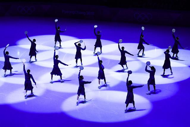 <p>Dancers perform during the figure skating gala event during the Pyeongchang 2018 Winter Olympic Games at the Gangneung Oval in Gangneung on February 25, 2018. / AFP PHOTO / ARIS MESSINIS (Photo credit should read ARIS MESSINIS/AFP/Getty Images) </p>