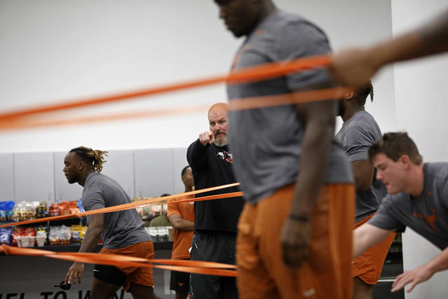 Texas Longhorns head strength and conditioning coach for football Yancy McKnight (center) talks with players during their morning workout Wednesday Sept. 4, 2019 in Austin, Tx. ( Photo by Edward A. Ornelas )