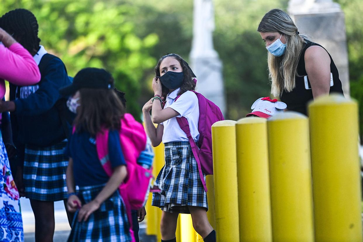 A student wears a facemask