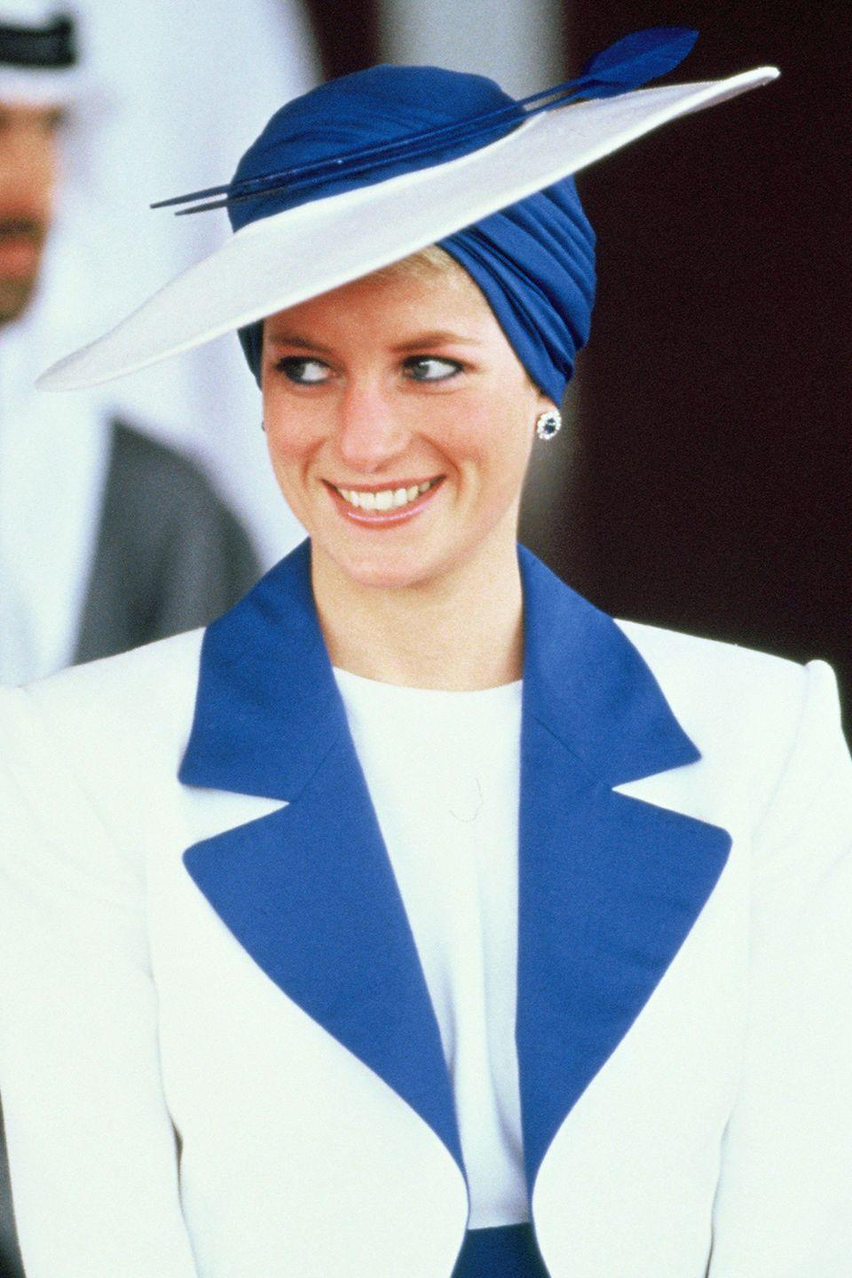 <p>In a blue-and-white Philip Somerville turban hat. </p>