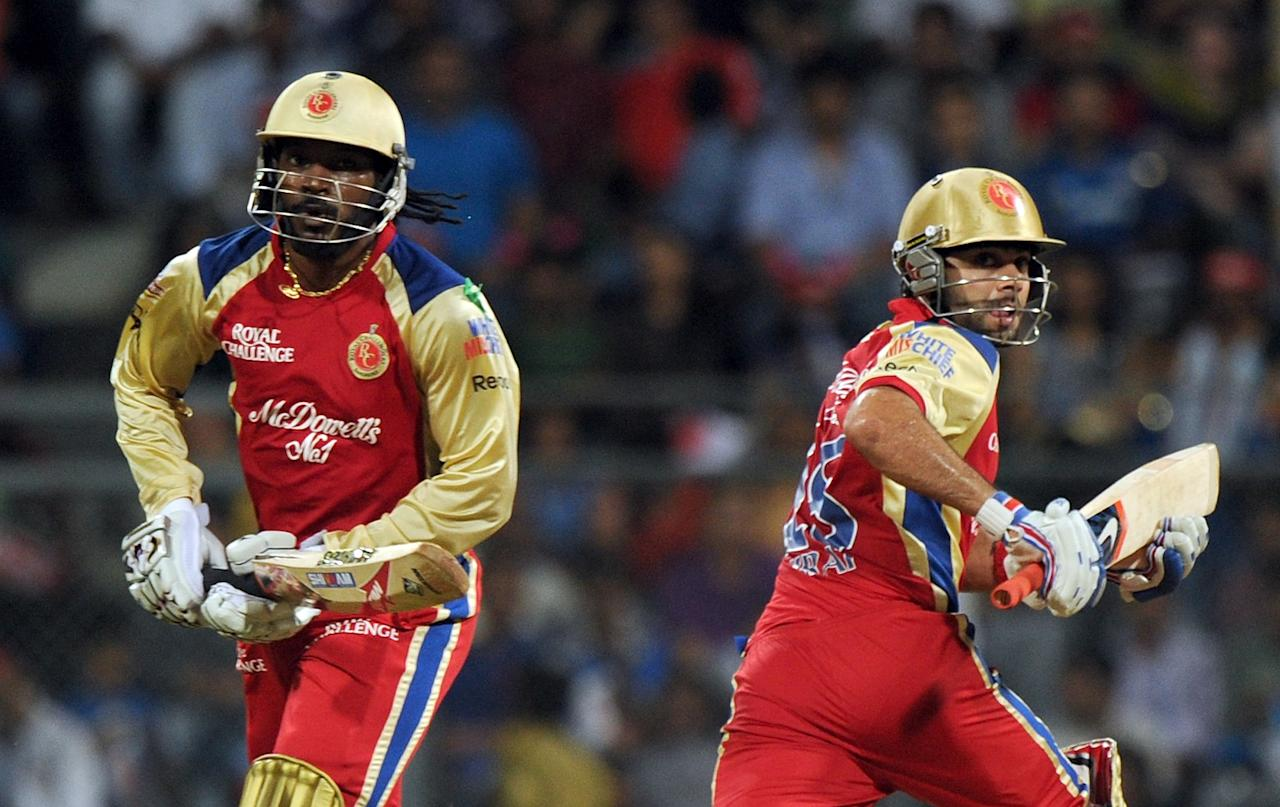 Royal Challengers Bangalore batsmen Chris Gayle (L) and Virat kohli takes a run during the IPL Twenty20 cricket match between Mumbai Indians and Royal Challengers Bangalore at The Wankhede Stadium in Mumbai on May 9, 2012.  RESTRICTED TO EDITORIAL USE. MOBILE USE WITHIN NEWS PACKAGE    AFP PHOTO/Indranil MUKHERJEE        (Photo credit should read INDRANIL MUKHERJEE/AFP/GettyImages)