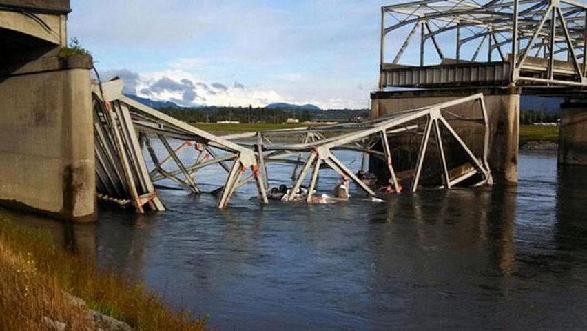 A Washington state bridge collapses, dumping 2 vehicles into the water north of Seattle