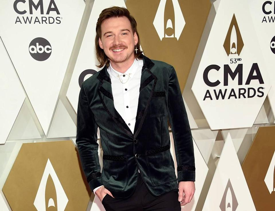 """FILE - Morgan Wallen arrives at the 53rd annual CMA Awards on Nov. 13, 2019, in Nashville, Tenn. Wallen said it was ignorant of him to use a racial slur. In his first interview in six months, Wallen talked to Michael Strahan on ABC's """"Good Morning America."""" on Friday, July 23, 2021. (Photo by Evan Agostini/Invision/AP, File)"""
