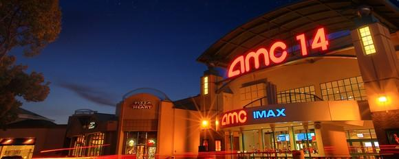 The exterior of AMC 14 theater at Saratoga at night.