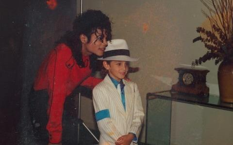 A young Wade Robson with Michael Jackson, who he met at the age of five