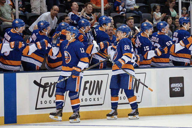 New York Islanders Kieffer Bellows, (20) celebrates with team mates after scoring, during the first period of a preseason NHL hockey game against Philadelphia Flyers in New York, Sunday, Sept. 16, 2018. (AP Photo/Andres Kudacki)