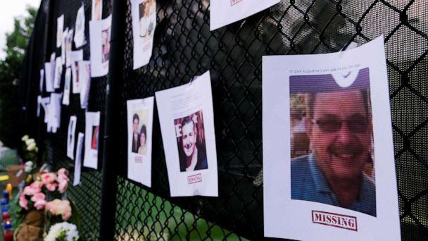 PHOTO: Pictures of missing people are seen hanging on a fence at a memorial on Harding Avenue as the rescue personnel continue their search for victims the day after a partial building collapse in Surfside near Miami Beach, Floa., June 25, 2021.  (Maria Alejandra Cardona/Reuters)