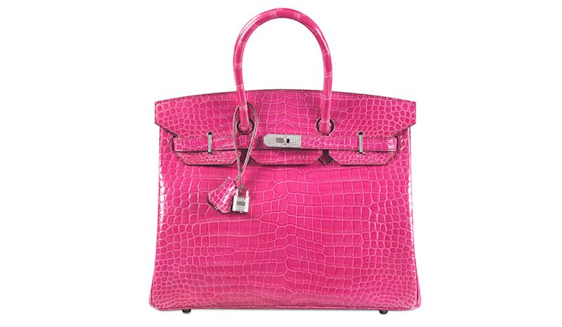 </a> The crocodile-skin Hermes Birkin bag broke the record for the most expensive handbag sold at auction, selling for $222,912 at a Christie's auction in Hong Kong.Courtesy of Christie's