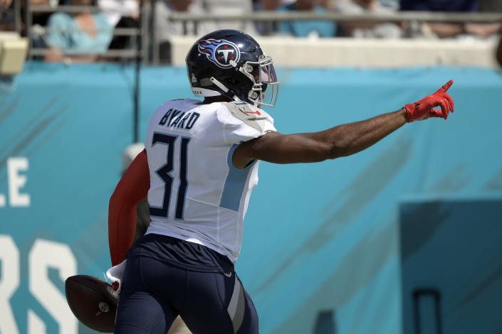 Tennessee Titans free safety Kevin Byard (31) celebrates after scooping up a Jacksonville Jaguars fumble and returning it 30-yars for a touchdown during the first half of an NFL football game, Sunday, Oct. 10, 2021, in Jacksonville, Fla. (AP Photo/Phelan M. Ebenhack)