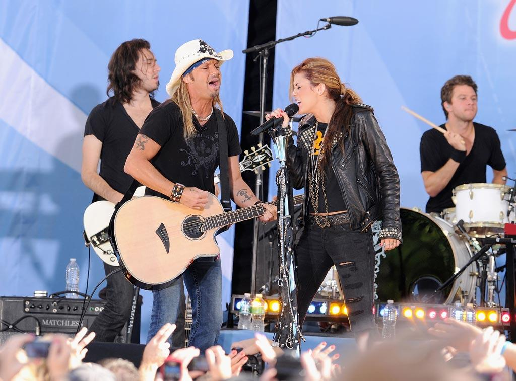 """The entertainer broke out a more rock 'n' roll image when she took the stage in June 2010 with former Poison frontman Bret Michaels to duet on """"Every Rose Has Its Thorn,"""" a tune Miley covered on her new, more mature album, <i>Can't Be Tamed</i>. When Miley's parents filed for divorce in October, rumors swirled that the cause was Tish had had an alleged affair with the 47-year-old. Miley and Bret had also caused a stir a few months earlier with their controversial duet, """"Nothing to Lose,"""" featuring lyrics some argued were too racy. Jamie McCarthy/<a href=""""http://www.wireimage.com"""" target=""""new"""">WireImage.com</a> - June 18, 2010"""