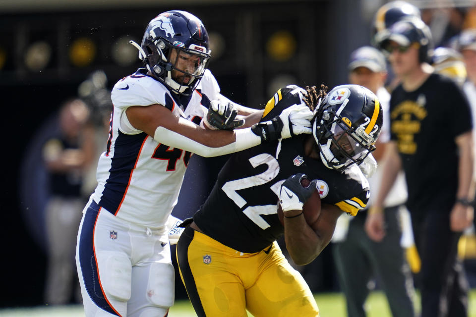 Pittsburgh Steelers running back Najee Harris (22) is shoved out of bounds by Denver Broncos inside linebacker Justin Strnad (40) during the first half of an NFL football game in Pittsburgh, Sunday, Oct. 10, 2021. (AP Photo/Keith Srakocic)