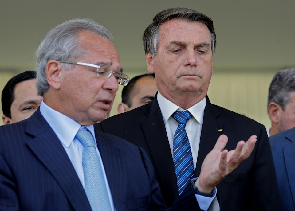Brazilian Economy Minister Paulo Guedes (L) speaks next to Brazilian President Jair Bolsonaro (R) during a statement on financial aid for vulnerable Brazilians amid the COVID-19 pandemic, at Planalto Palace, in Brasilia, on September 1, 2020. - Brazil announced a reduction of 9.1% in the gross domestic product. (Photo by Sergio Lima / AFP) (Photo by SERGIO LIMA/AFP via Getty Images)