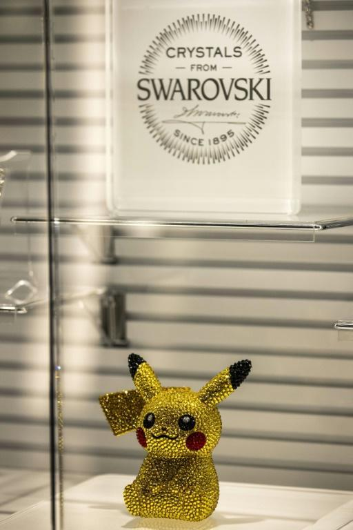 A statuette of Pokemon game character Pikachu, studded with Swarovski crystals, is displayed at a Pokemon store in Tokyo