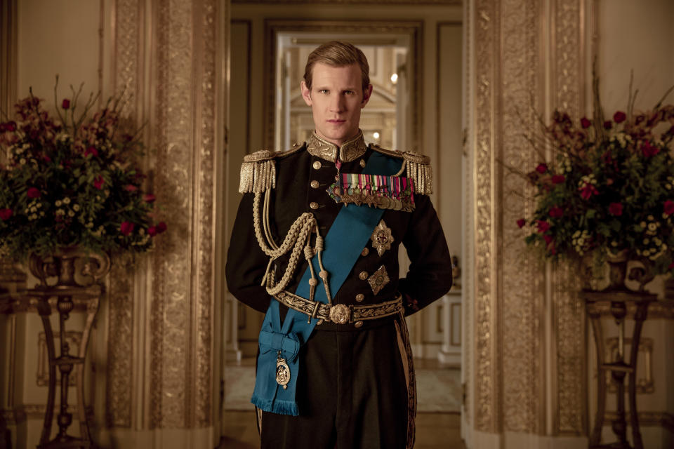 """This image released by Netflix shows Matt Smith as Prince Philip from """"The Crown."""" Britain's Prince Philip stood loyally behind behind Queen Elizabeth, as his character does on Netflix's """"The Crown."""" But how closely does the TV character match the real prince, who died Friday, April 9, 2021 at 99? Philip is depicted as a man of action in """"The Crown,"""" and he served with distinction in the navy in World War II. He was also an avid yachtsman and polo player. (Netflix via AP)"""