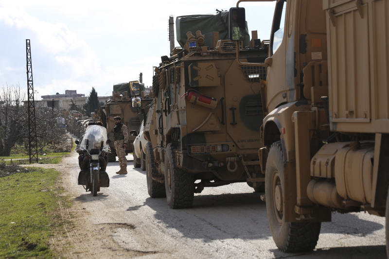 Turkish military convoy stops in Idlib province, Syria, Saturday, Feb. 22, 2020. A Turkish soldier was killed in Syria's northwest Idlib province, state-run Anadolu news agency reported Saturday. (AP Photo/Ghaith Alsayed)