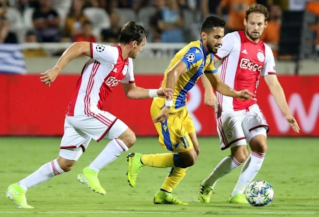 APOEL midfielder Musa Suleiman gave Nicolas Tagliafico and Daley Blind and the Ajax defense a difficult time (AFP Photo/)