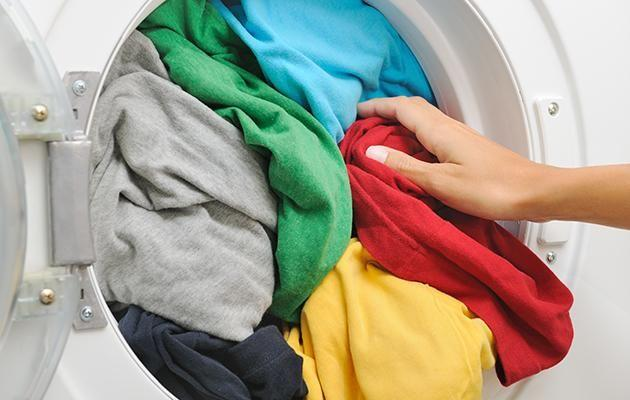 Keep your laundry clean by using big IKEA bags to store your clothes. Photo: Getty