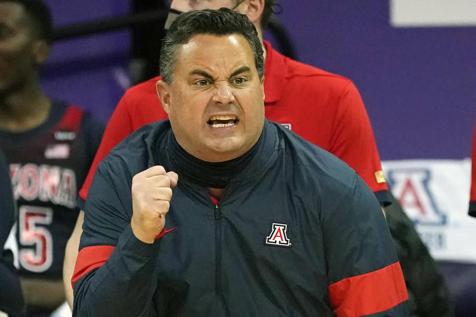 FILE - Arizona head coach Sean Miller motions toward the court in the first half of an NCAA college basketball game against Washington in Seattle, in this Thursday, Dec. 31, 2020, file photo. Arizona has parted ways with men's basketball coach Sean Miller as the program awaits its fate in an NCAA infractions investigation, a person with knowledge of the situation told The Associated Press. The person told the AP on condition of anonymity Wednesday, April 7, 2021, because no official announcement has been made. (AP Photo/Elaine Thompson, File)