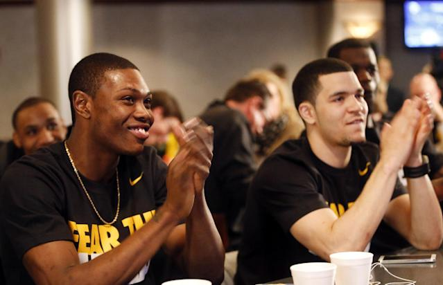 Wichita State's Cleanthony Early, left, and Fred VanVleet clap after the team earns a No. 1 seed during an NCAA college basketball Selection Sunday watch party, Sunday, March 16, 2014, in Wichita, Kan. (AP Photo/The Wichita Eagle, Jaime Green)