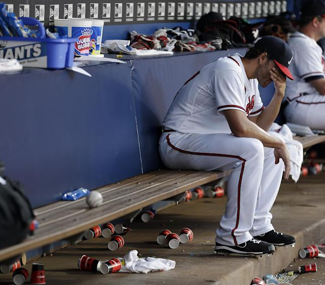 Atlanta Braves starting pitcher Brandon Beachy (37) sits in the dugout after being relieved in the fourth inning of a baseball game against the Colorado Rockies in Atlanta, Monday, July 29, 2013. Beachy was making his first start of the season after having elbow sugery. (AP Photo/John Bazemore)