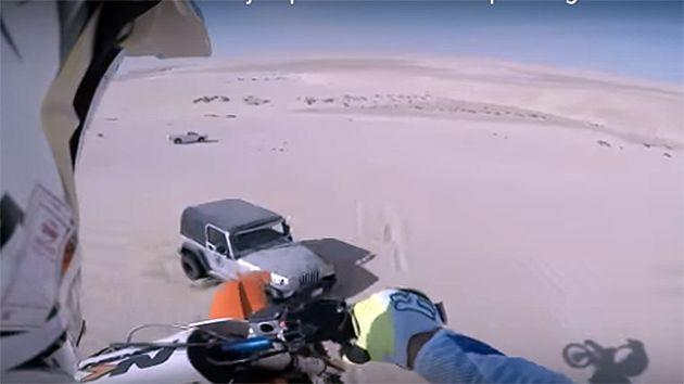 The rider just before he makes contact with the jeep. Pic: YouTube/desert bikes