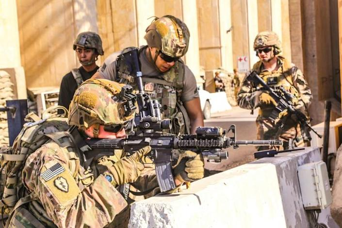 Additional American soldiers were sent last week to reinforce the embassy in the capital Baghdad, after a pro-Iran mob breached the outer wall (AFP Photo/-)