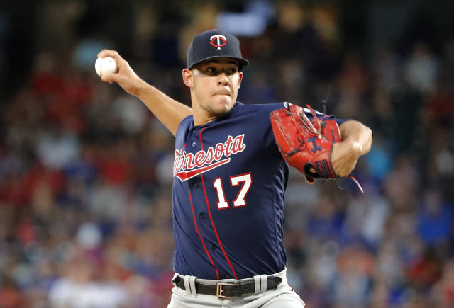 Minnesota Twins starting pitcher Jose Berrios throws to a Texas Rangers batter during the first inning of a baseball game in Arlington, Texas, Saturday, Aug. 17, 2019. (AP Photo/Tony Gutierrez)