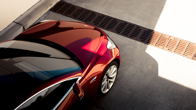 An overhead shot of a red Tesla Model 3