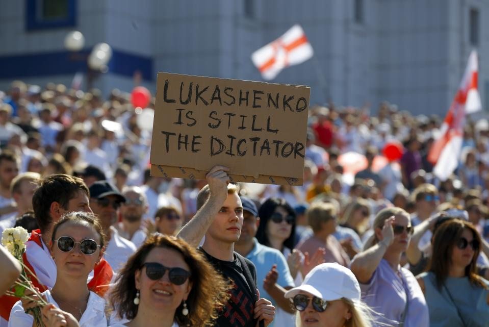 Belarusian opposition supporters rally in the center of Minsk, Belarus, Sunday, Aug. 16, 2020. Opposition supporters whose protests have convulsed the country for a week aim to hold a major march in the capital of Belarus. Protests began late on Aug. 9 at the closing of presidential elections. (AP Photo/Sergei Grits)