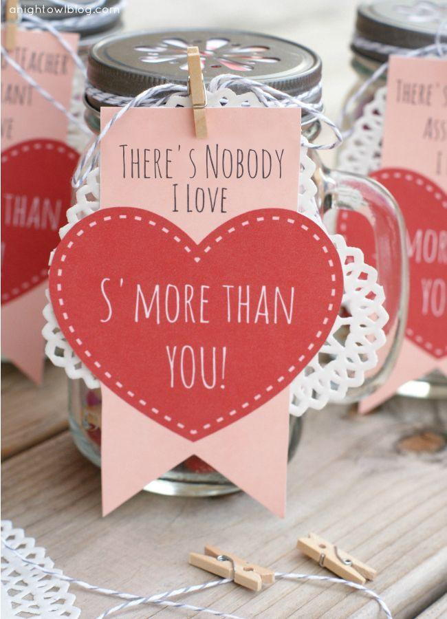 """<p>Cute gift alert! Make a s'mores snack mix of M&M's, marshmallows, and graham cracker Goldfish, then print out blogger Kimberly's cute printable to top it off. </p><p><strong>Get the tutorial at </strong><a href=""""http://anightowlblog.com/2014/02/smores-valentines.html/"""" rel=""""nofollow noopener"""" target=""""_blank"""" data-ylk=""""slk:A Night Owl."""" class=""""link rapid-noclick-resp""""><strong>A Night Owl.</strong></a></p><p><a class=""""link rapid-noclick-resp"""" href=""""https://www.amazon.com/300pcs-Valentine-Heart-Doilies-Paper/dp/B01MU6TEP3/ref=sr_1_2_sspa?tag=syn-yahoo-20&ascsubtag=%5Bartid%7C10050.g.93%5Bsrc%7Cyahoo-us"""" rel=""""nofollow noopener"""" target=""""_blank"""" data-ylk=""""slk:SHOP DOILIES"""">SHOP DOILIES</a></p>"""
