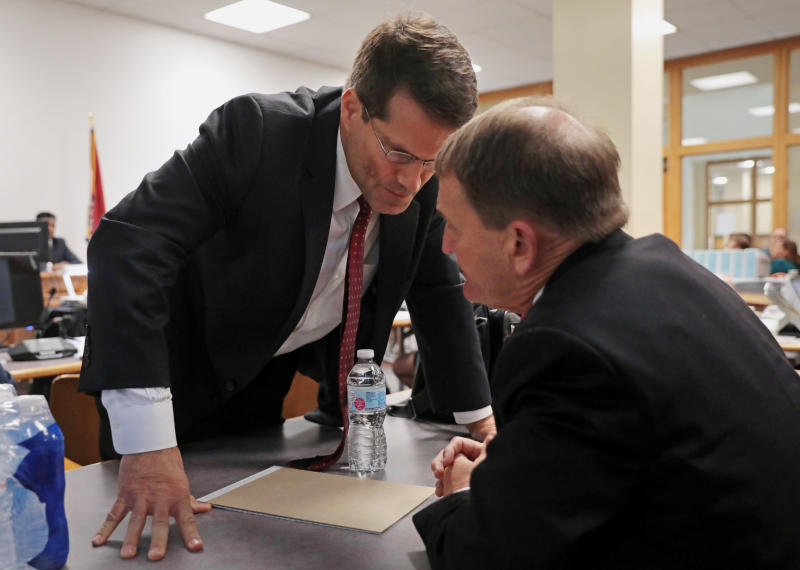 Assistant Missouri Attorney General John Sauer, left, talks with Dr. Randall Williams, director of the Missouri Department of Health and Senior Services, during the first day of hearings between Planned Parenthood and the Missouri Department of Health and Senior Services at the Wainwright State Office Building in downtown St. Louis on Monday, Oct. 28, 2019. (Cristina M. Fletes/St. Louis Post-Dispatch via AP)