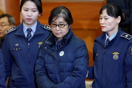 Choi Soon-sil arrives for a hearing arguments for South Korean President Park Geun-hye's impeachment trial at the Constitutional Court in Seoul