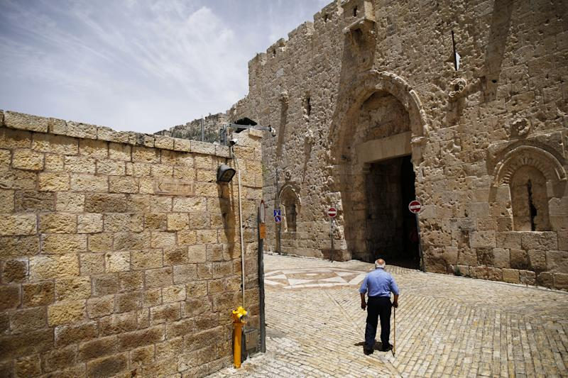 A man walks near Zion Gate in Jerusalem's Old City. (Photo: Nir Elias/Reuters)