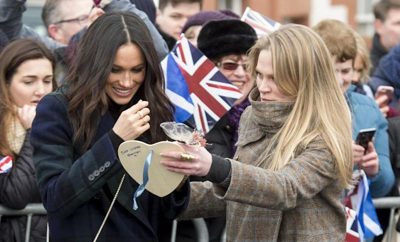 Amy is pictured taking gifts from Meghan in Scotland this week. Photo: Getty Images