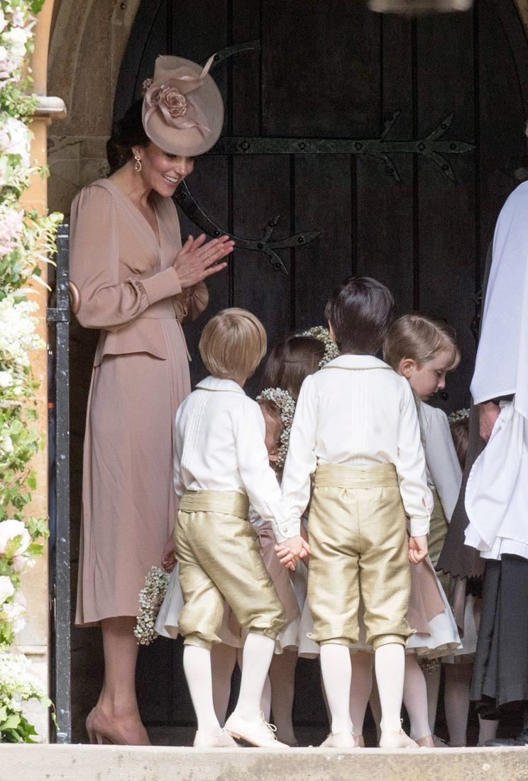 Kate shares a sweet moment with the children before entering the church [Photo: PA]